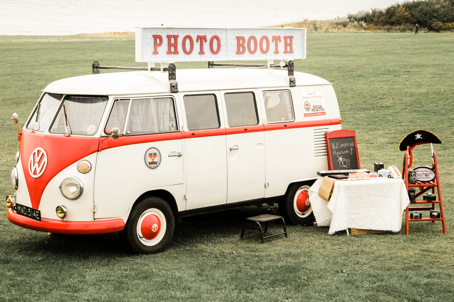 retro vw camper van photo booth outdoor wedding by the sea