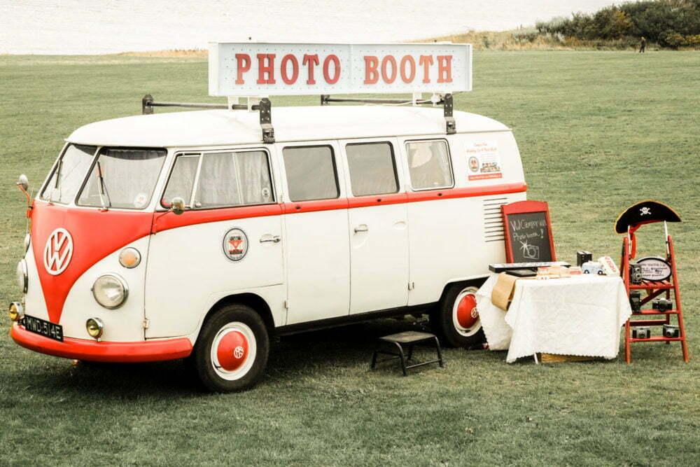 retro vw camper van photo booth outdoor wedding by the sea
