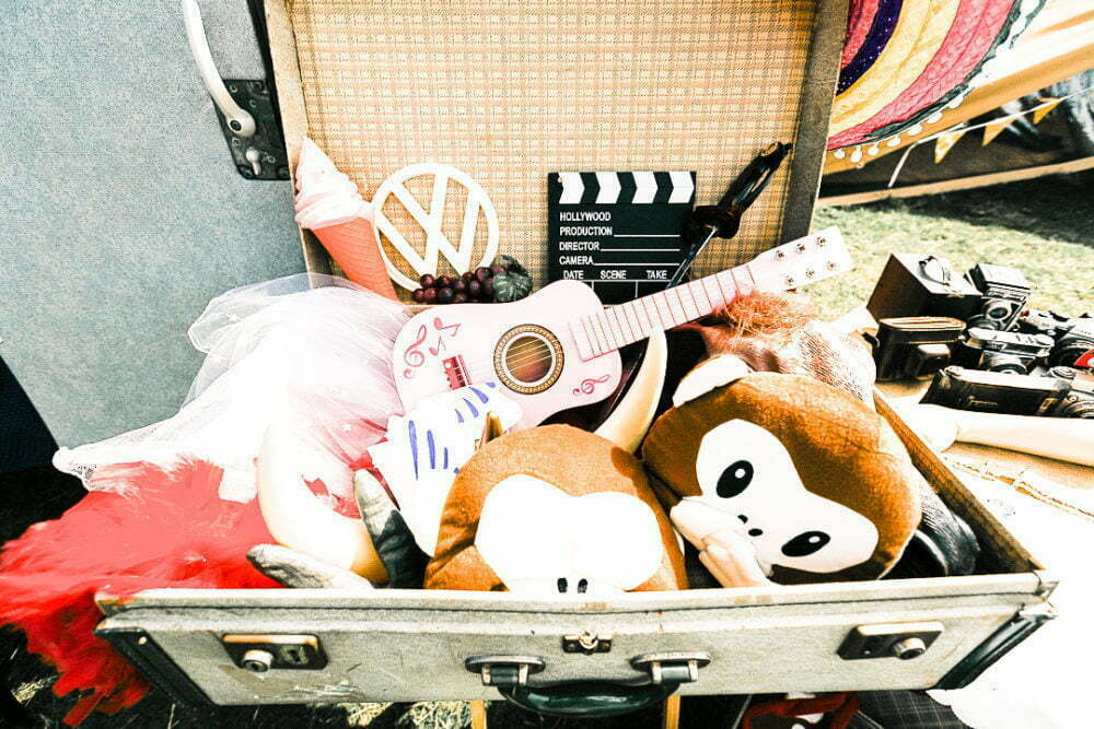 vintage suitcase full of photo booth props