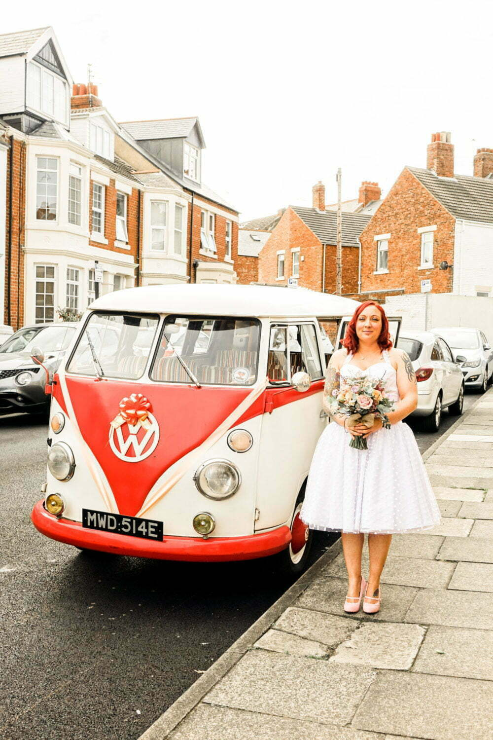 Bride in Wedding Dress with VW Wedding Car Hire in Whitley Bay North East