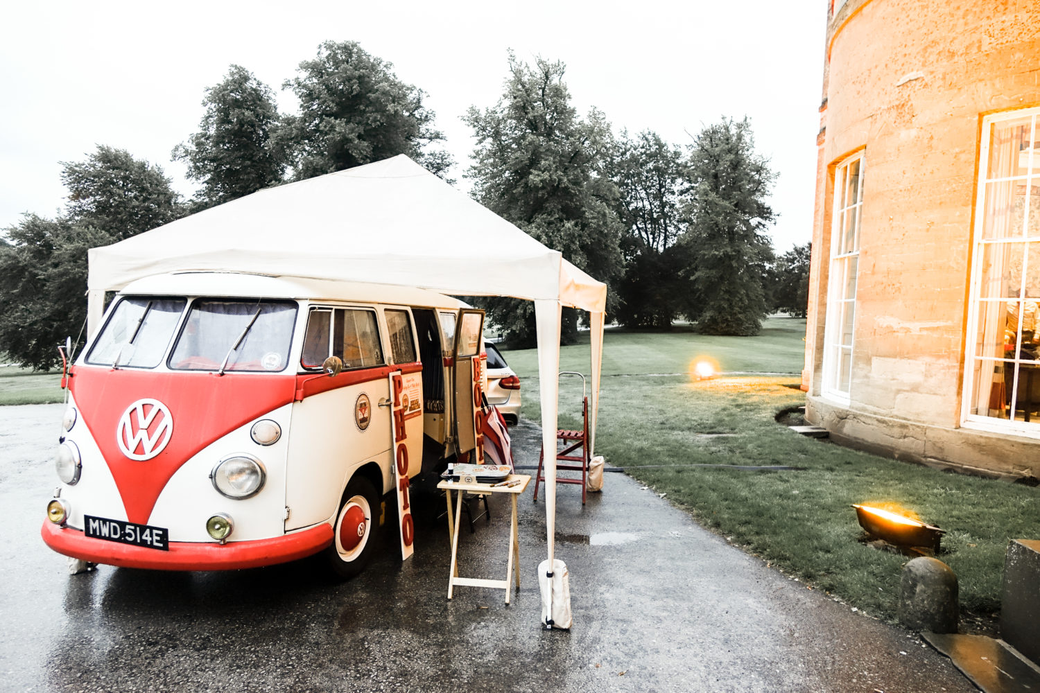 vintage campervan photobooth in the rain gazebo up