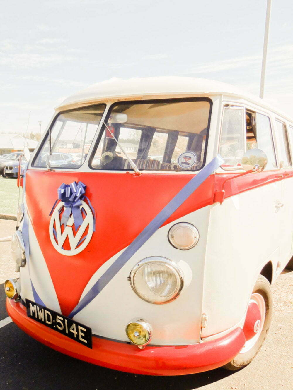 VW Wedding Car hire with blue ribbons and bows