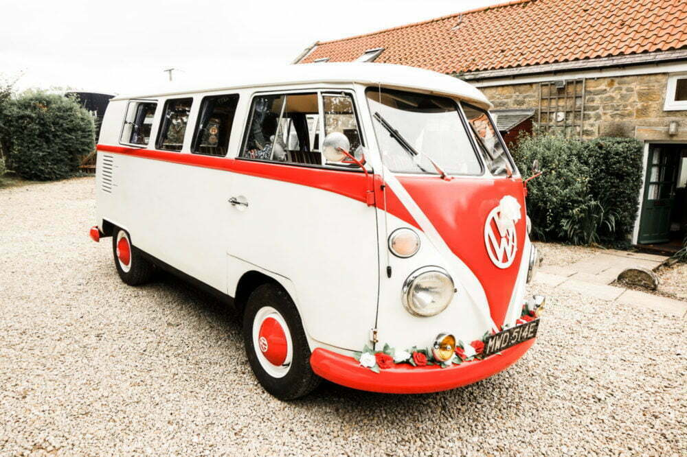 Red and Cream VW Camper Van Classic Wedding Car set up with ribbons bows and roses