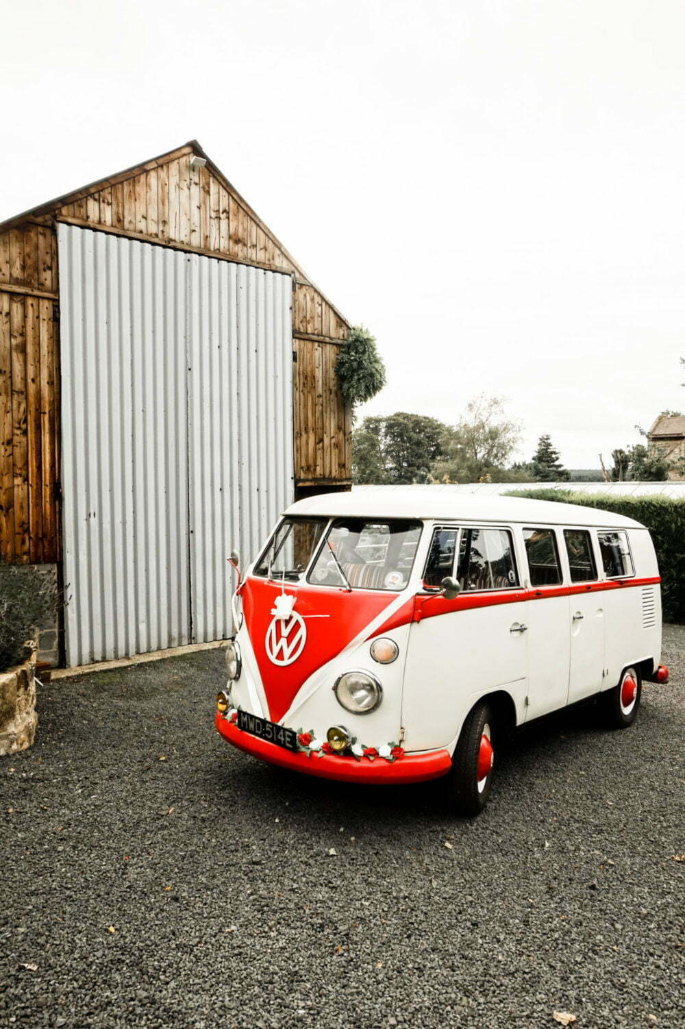 A Classic Split Screen Camper outside a Barn Wedding Venue Northumberland