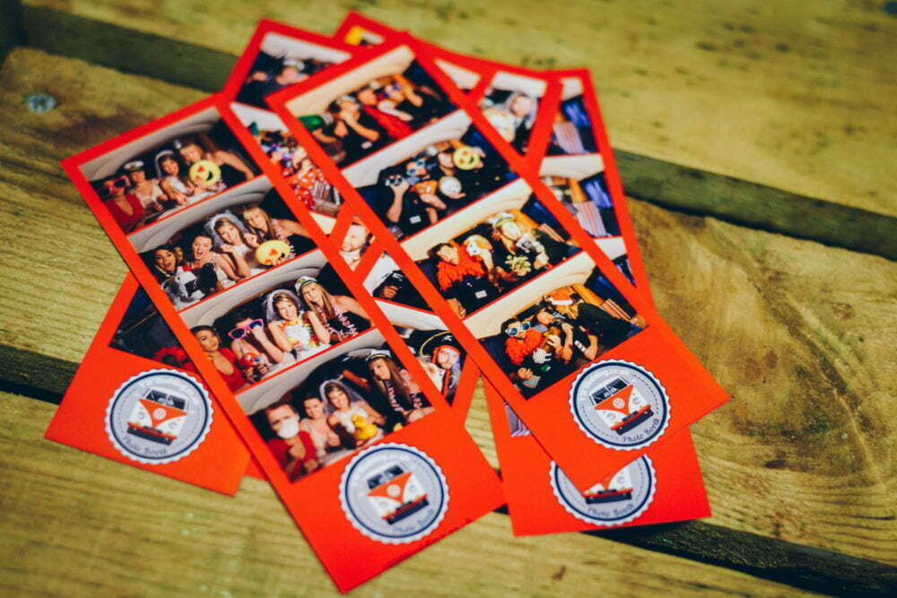 Pile of photo booth strips vw wedding rosie campervan logo on