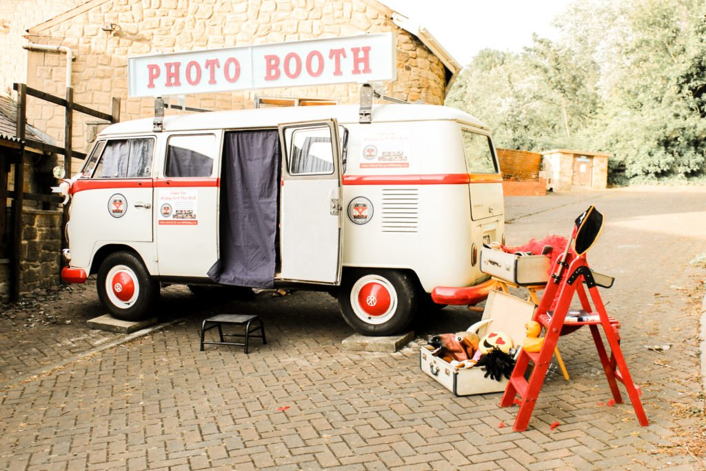 camper photo booth all set up with props