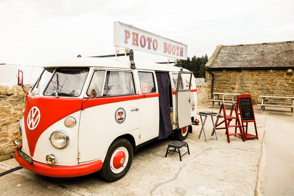 vintage VW photobooth in farm courtyard